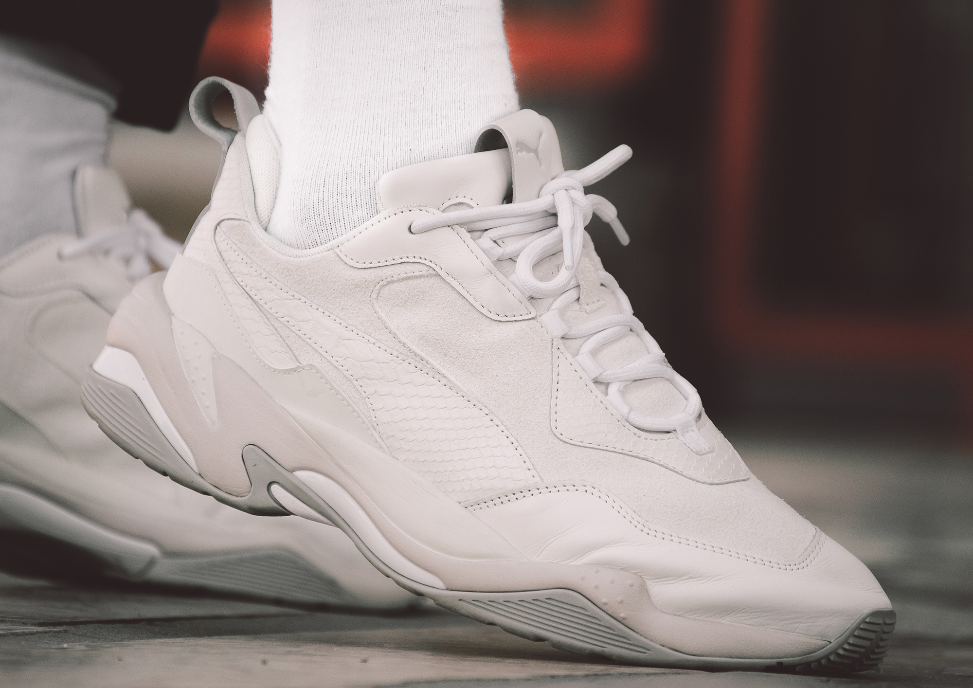b03ae10a80a0 ... PUMA Thunder Desert styled alongside chino pants